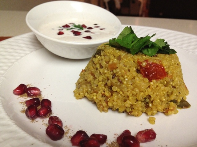 Quinoa topped with almonds and jalapeños & a chilled Pomegranate Raita