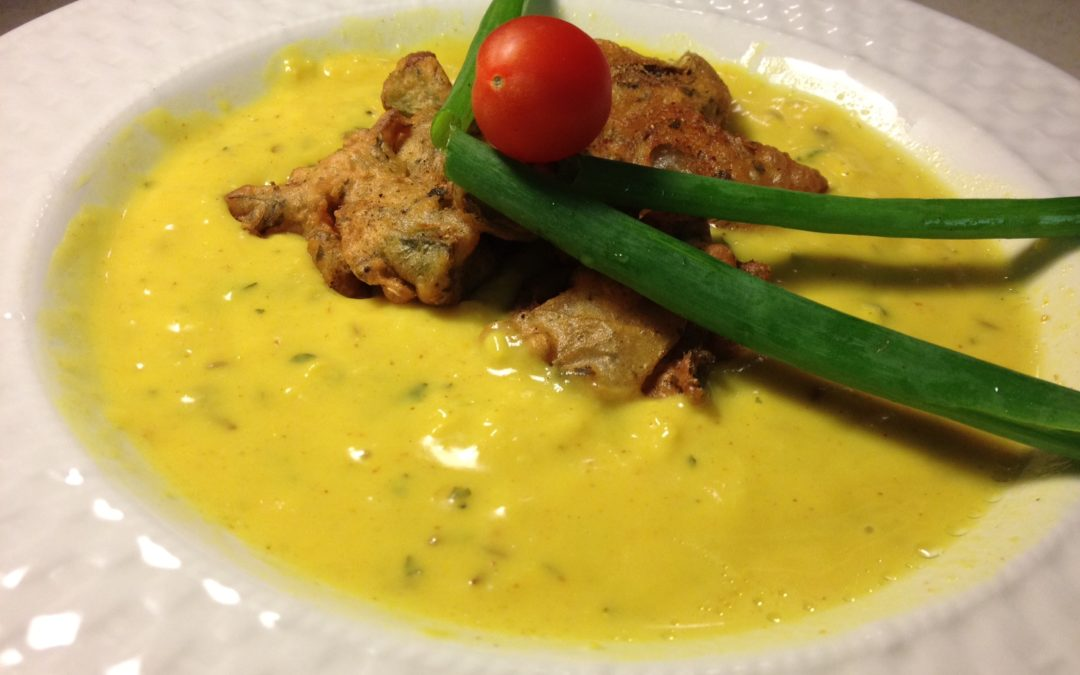 Vegetable fritters in a spicy yogurt sauce