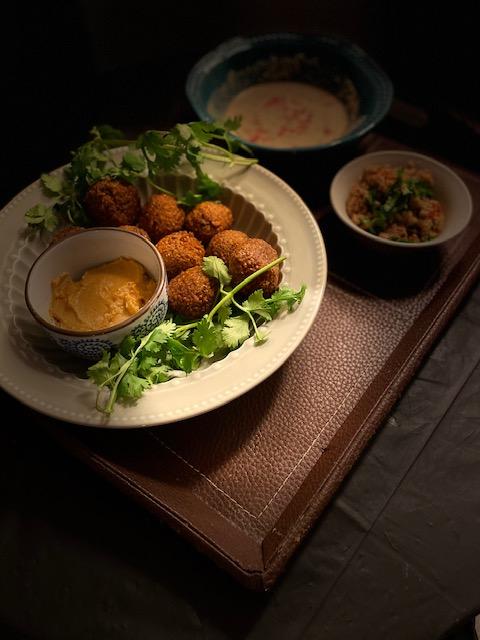 Falafels with tahini sauce, hummus & babaganoush
